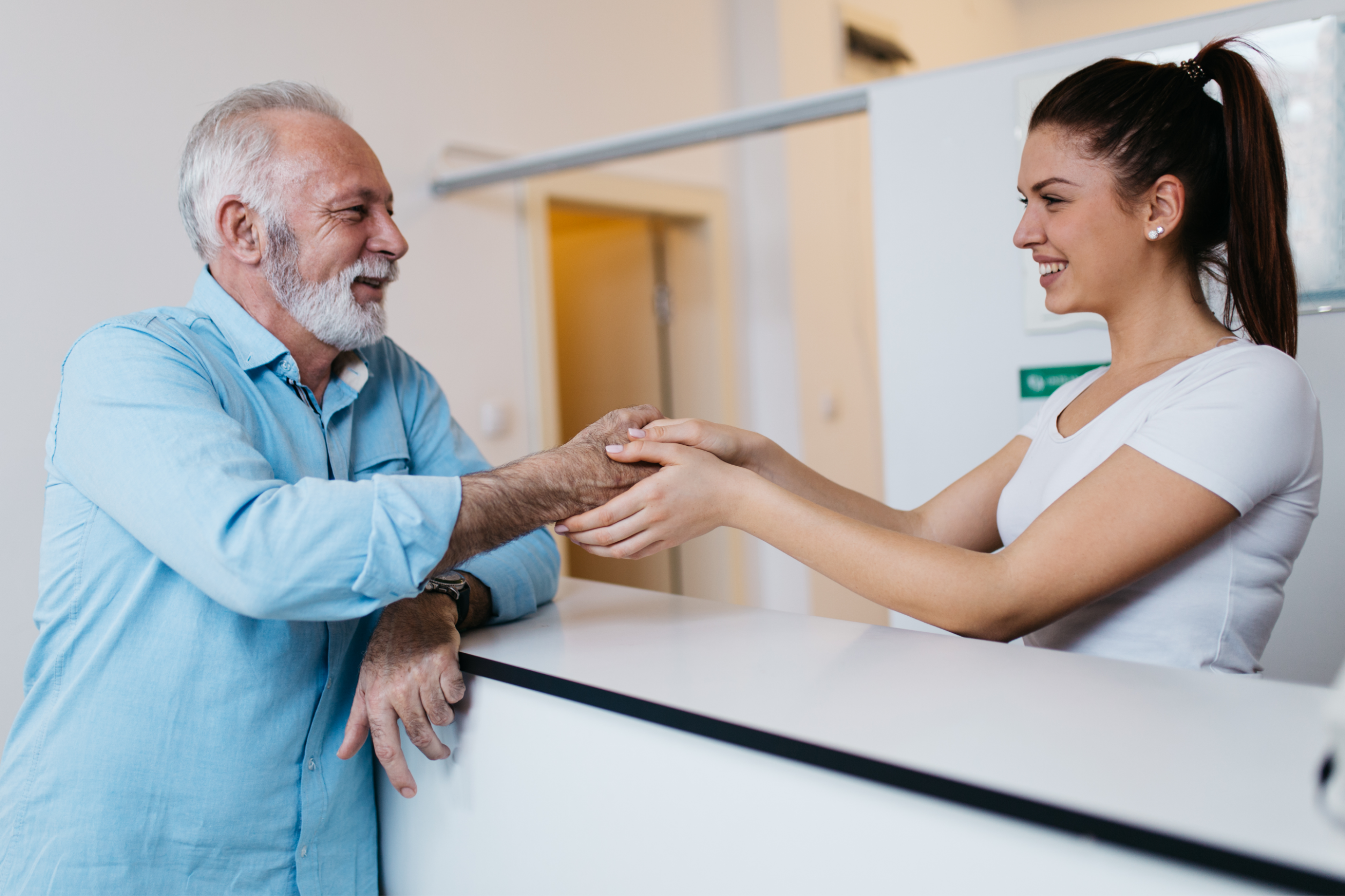 Man talking to woman about senior care franchise