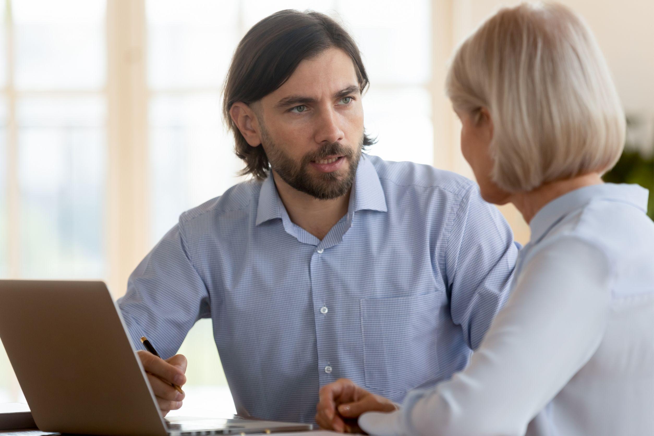 senior home care franchise owner talking to elder client