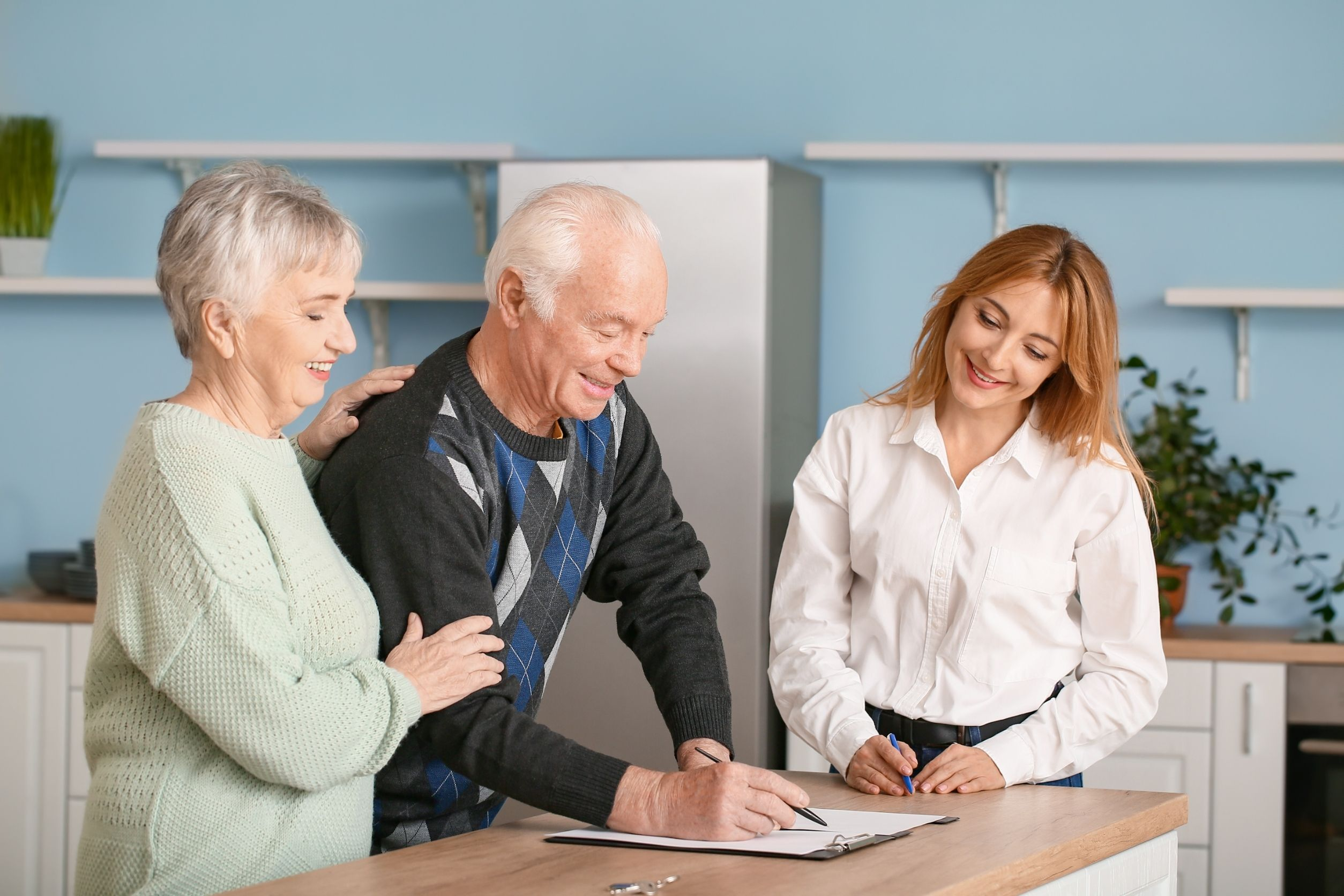 senior couple signing contract to receive senior care services